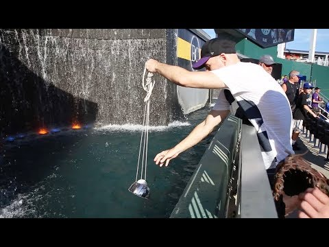 Scooping baseballs from the fountain at Kauffman Stadium