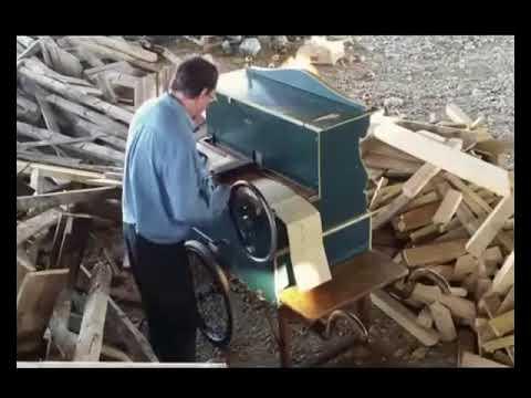 A Man Plays Eurobeat on a Barrel Organ in a Wood Pile