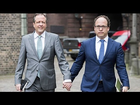 Men hold hands to protest anti-gay violence in the Netherlands