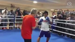 Manny Pacquiao bangs the punch mitts at at Pac Horn media workout