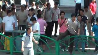 Han Chinese protest in tense Xinjiang city