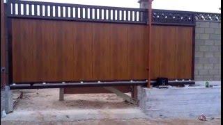 Автоматические откатные ворота DOORHAN с приводом FAAC C720(Откатные ворота из панелей золотой дуб в комбинации с алюминиевой решеткой сверху., 2016-03-02T13:42:27.000Z)