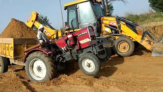 Eicher 241 tractor stuck in soil with loaded trolly