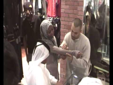 DJ GQ Signing Autograph on 's shirt at the Hip hop shop