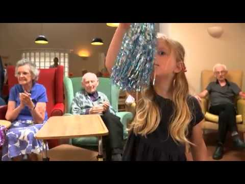 Care home residents experiencing therapy with toddlers