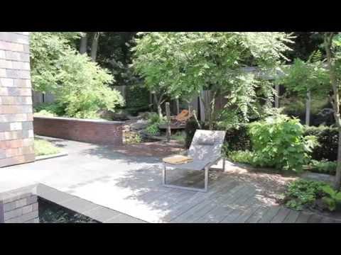 Van mierlo tuinen luxe bostuin met zwembad en waterloop