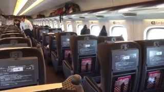 Taking the Shinkansen (Bullet Train) from Tokyo to Osaka.