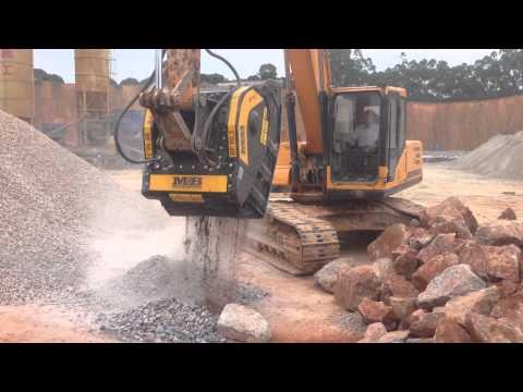 MB Crusher Bucket Crushing Blue Granite In China
