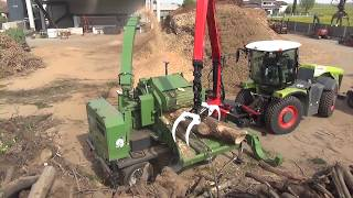 PTH 1200-1000 Pezzolato drum wood chipper powered by CLASS XERION 5000 500 Hp tractor