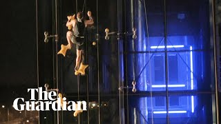 Speed climber takes on lift in six-storey vertical sprint ... and wins