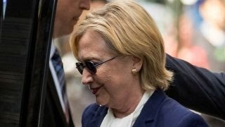 Video appears to show Clinton collapse as she leaves event