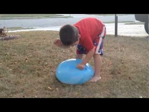 boy struggles to pop big water balloon youtube. Black Bedroom Furniture Sets. Home Design Ideas