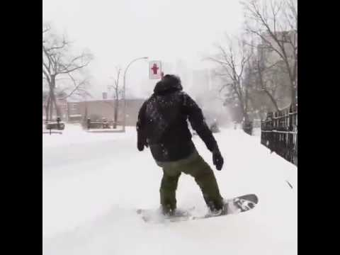 Snowboarder on street in Montreal