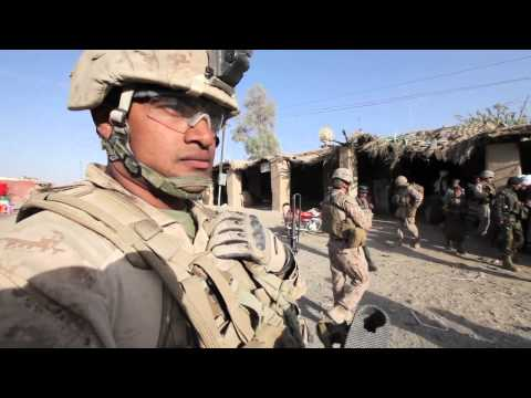 U.S. Marines and Afghan Forces with VIP patrol through KAJAK