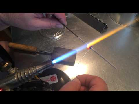 Using silver wire on lampwork beads by Paulbead