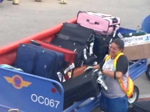Loading Luggage on Airplane