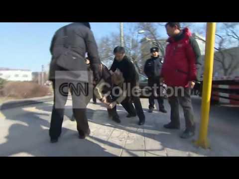 CHINA   POLICE ATTACK CNN CREW ON CAM!