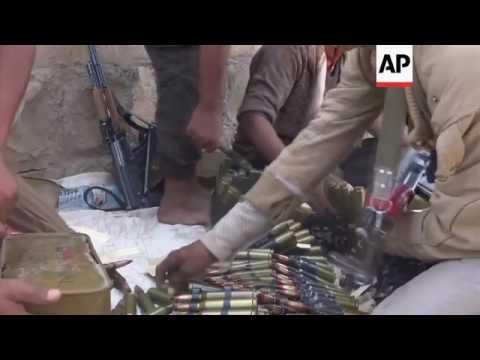 Militias battle in Houthi mountain areas