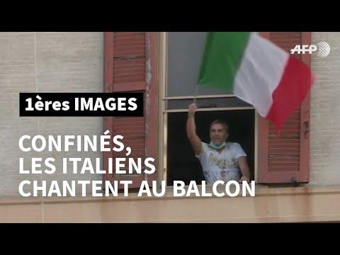 Rome: confinés chez eux, les Italiens chantent au balcon   AFP Images