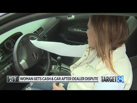 Woman gets cash and car after dealer dispute