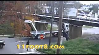 Semi gets bent out of shape at the 11foot8 bridge