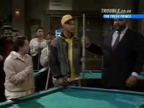 Black guys play by a pool
