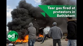 2017-12-08-12-22.Tear-gas-fired-as-Trump-s-comments-spark-protests