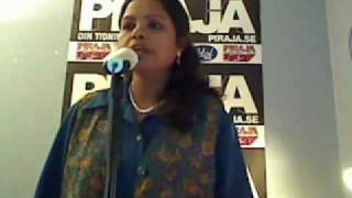 Indian lady singing We Will Rock You