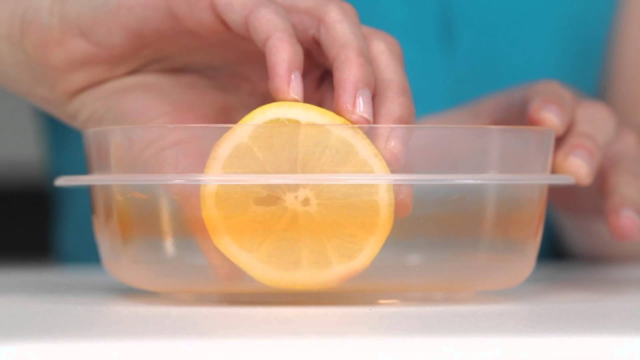How To Use A Lemon Clean Stained Food Containers Real Simple