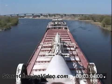 Time-Lapse stock footage of the great lakes freighter Wilfred Sykes coming and leaving port.