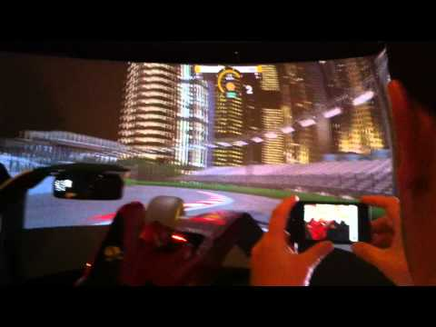 Ferrari's driver Fernando Alonso trying a driving simulator in Singapore