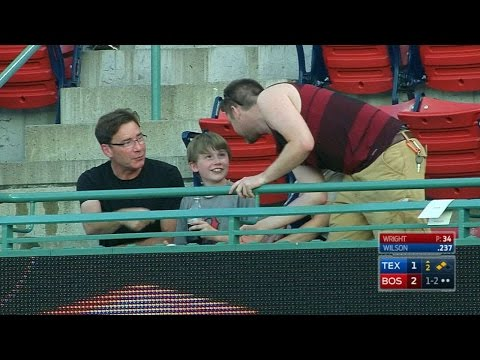 Fan catches foul, gives ball to young kid