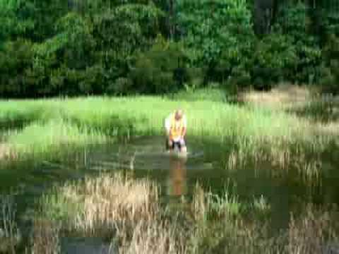 Land Surveyor in retention pond