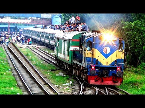 Container Freight Train crossing Sundarban Express Train near Dhaka Airport Railway Station