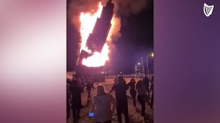 Moment giant bonfire collapses in Northern Ireland