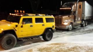 Hummer H2 pulling a semi truck