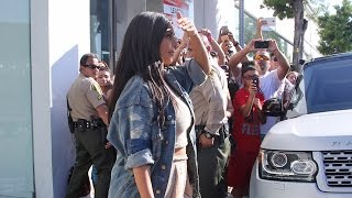 Pregnant Kim Kardashian Is Too Busy For Fans At Dash with Khloe And Kourtney