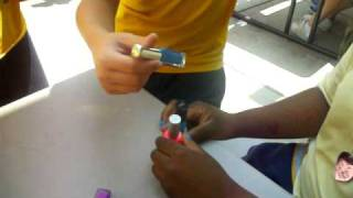 Boys getting their nails painted.