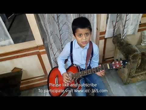 Guitar playing by small Boy