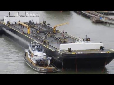 Two tugs helping tank barge 65 Roses