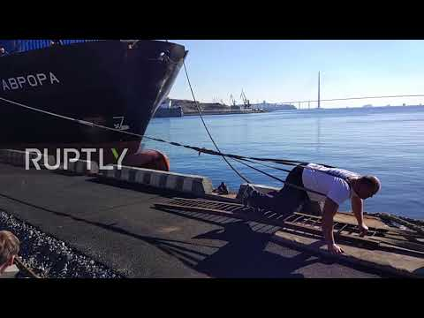 Break records, not backs - Watch Russian strongman pull 5000-TONNE vessel in Vladivostok