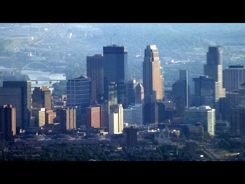 Downtown Minneapolis on flight to Kansas City: takeoff, clim