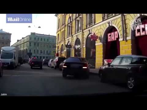 Video reveals angry pedestrian smashing car window with his FIST in St Petersburg  Daily Mail Online