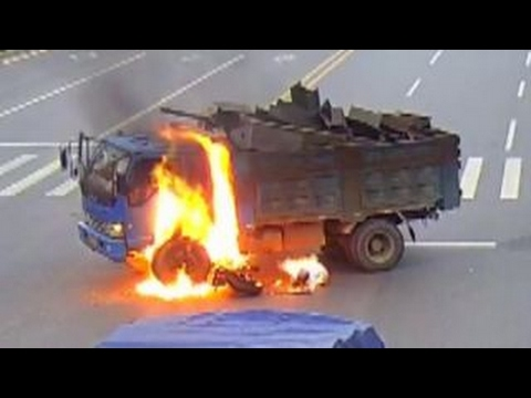 Warning, graphic content: Biker escapes fiery crash