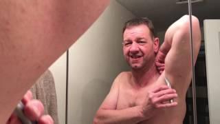 Man shaves pits