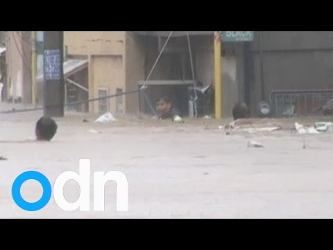 Philippines floods: Thousands flee Manila, one dead