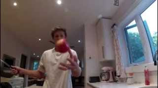 Slicing an apple in half. Slow motion
