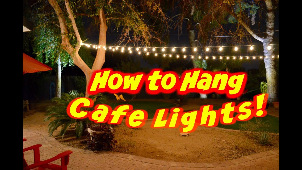 how to hang outdoor cafe lights or string lights on a wire [ 1280 x 720 Pixel ]