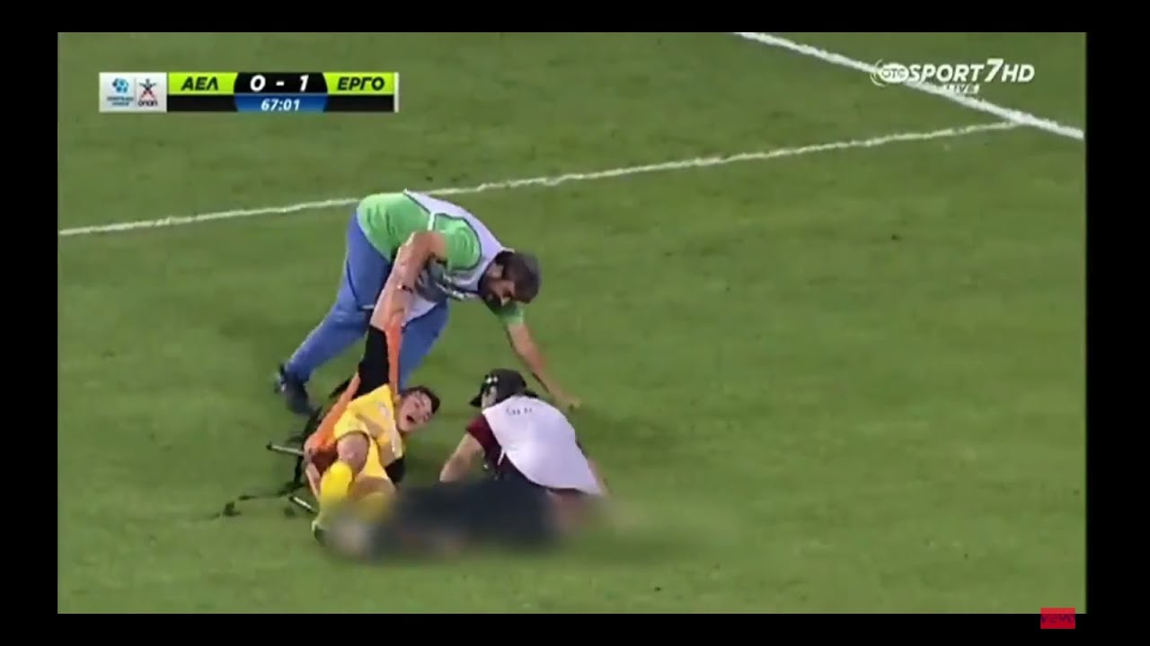 Download Greek stretcher-bearer falls over twice, drops injured player