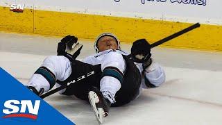 Flames' Sam Bennett Rocks Sharks' Radim Simek With Late Hit